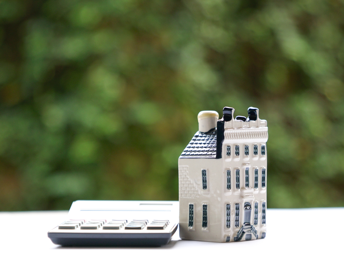 Calculator and commercial real estate refinancing property